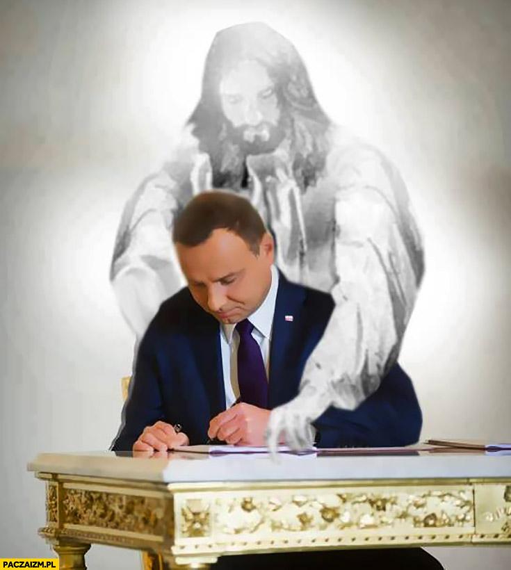 Andrzej Duda podpisuje Jezus pokazuje co podpisać