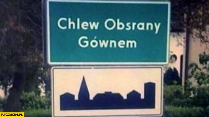 Chlew obsrany gównem tabliczka z nazwa miejscowości