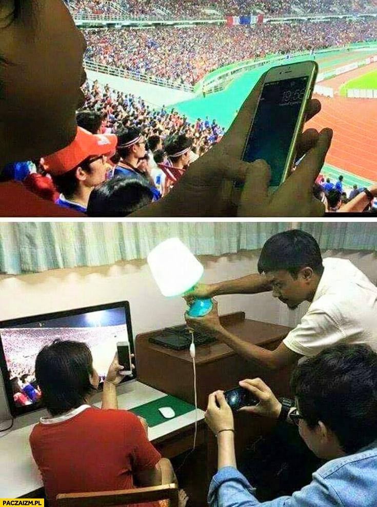 Gość udaje że jest na meczu przed telewizorem