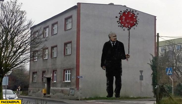 Kaczyński z balonikiem koronawirus mural graffiti malunek na budynku