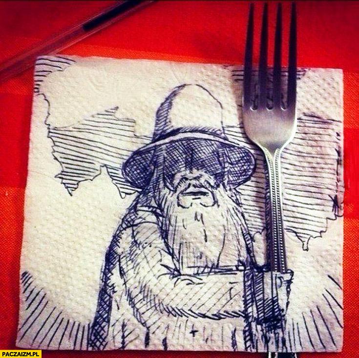 Kreatywny rysunek na serwetce mędrzec trzymający widelec