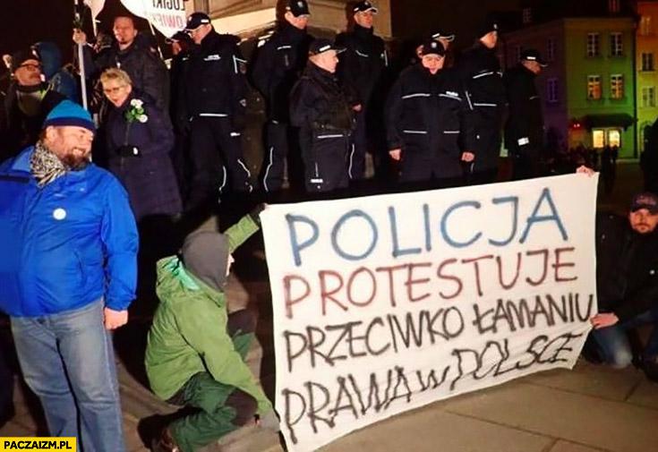 Policja protestuje przeciwko łamaniu prawa w Polsce transparent napis