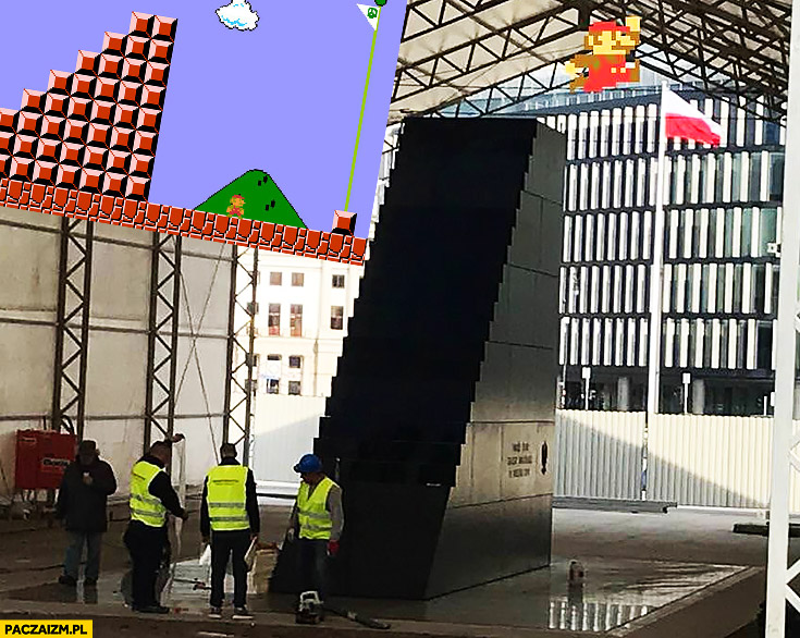 Pomnik Smoleński Mario Bros skacze po flagę