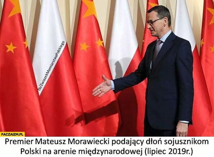 Premier Mateusz Morawiecki podający dłoń sojusznikom Polski na arenie międzynarodowej lipiec 2019