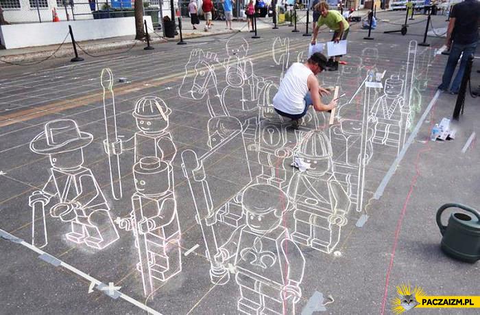 Trójwymiarowe lego na chodniku