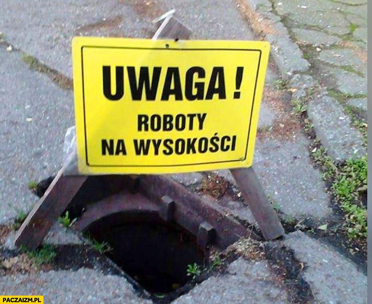 Uwaga roboty na wysokości dziura w ulicy